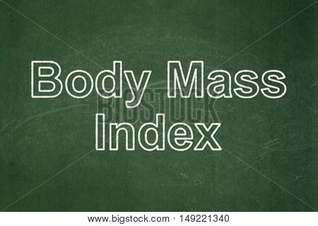 Medicine concept: text Body Mass Index on Green chalkboard background