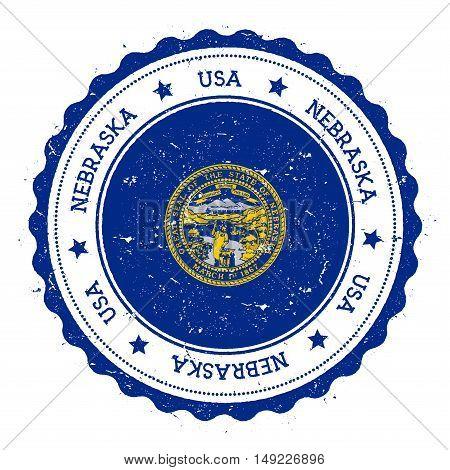 Nebraska Flag Badge. Grunge Rubber Stamp With Nebraska Flag. Vintage Travel Stamp With Circular Text