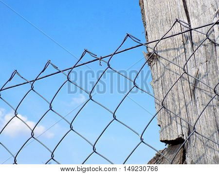 chain link fence and blue sky during day