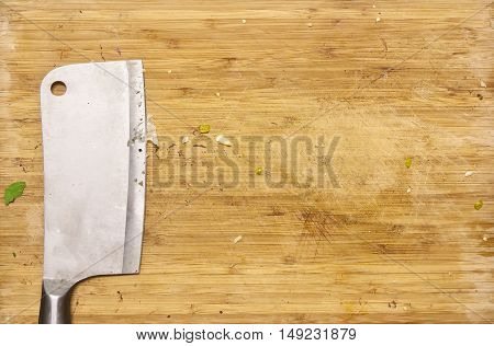 cleaver with wooden cutting board dirty because scrap top view