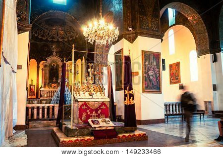 ETCHMIADZIN, ARMENIA - MARCH 22, 2016: Inside one of the oldest Cathedrals in the world. It has unique architectural style and design. Altar with chandelier