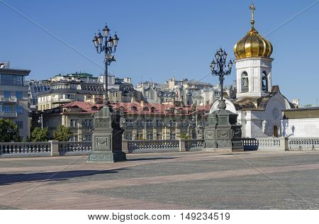 A fragment of the square at the Christ the Savior Cathedral in Moscow. View towards Soymonovsky proezd. Sunny August morning.