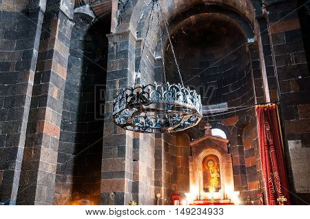 VAGHARSHAPAT, ARMENIA - MARCH 22, 2016: Inside a Saint Hripsime Apostolic Church. It has unique architectural style and design. Chandelier with icon