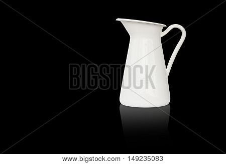 White milk jug beverage pitcher with reflection shadow on black isolated included clipping path on jug body only
