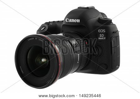 Varna Bulgaria - September 24 2016: Canon 5D Mark IV camera with Canon EF 16-35mm f/2.8L II USM lens on a white background. Canon is the world largest SLR camera manufacturer.