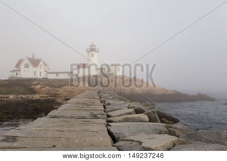 Eastern Point Lighthouse in Glouchester MA in heavy fog.