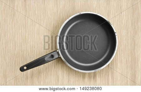top view empty pan on brown tablecloth for place food or text