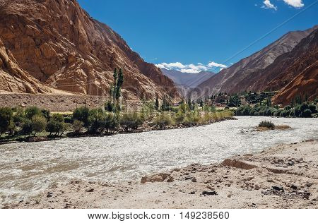 Little settlement in mountain near the Indus River