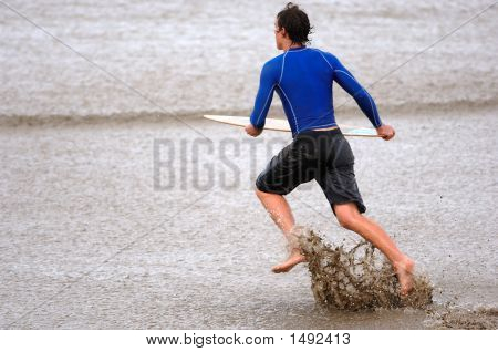 Skim Boarder At The Beach