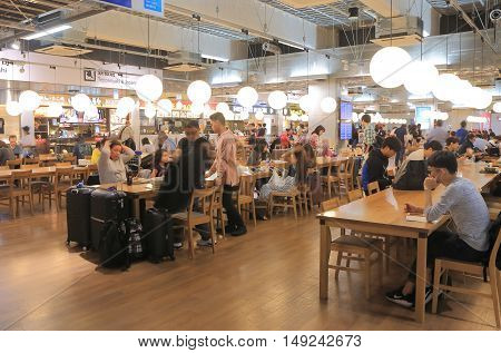 TOKYO JAPAN - SEPTEMBER 23, 2016: Unidentified people dine at Narita Airport food court.