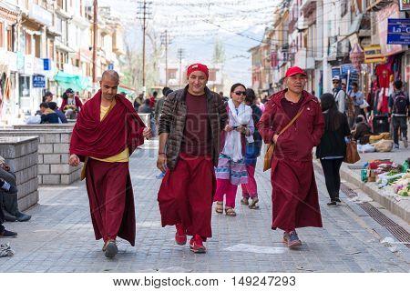 19 JULY 2016 - LEH LADAKH INDIA : Unidentified tibetan monks walking on leh market at Leh ladakh on 19 July 2016