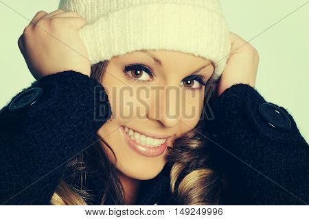 Beautiful smiling winter woman wearing hat