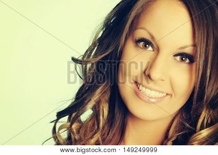 Beautiful young happy woman smiling