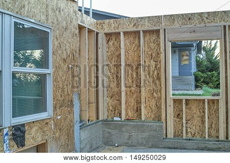 The former outside window will be removed once the addition is fully enclosed. The higher concrete is to compensate for the of the lawn.