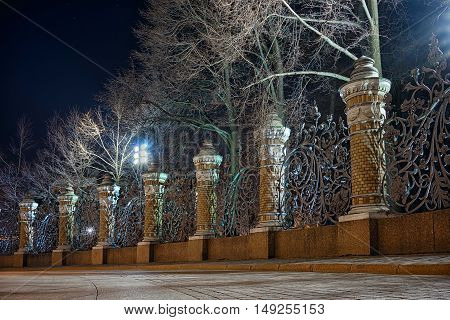 Night view of the fence of the Mikhailovsky Garden in the temple of Savior on Spilled Blood St.Petersburg