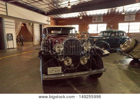 El Segundo, CA, USA - September 26, 2016: Maroon and black 1932 Buick convertible with a white soft top displayed at the Automobile Driving Museum in El Segundo, California, United States. Editorial use only.