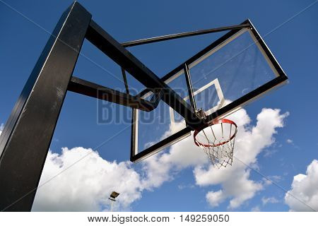 Basketball stand with a hoop on sky background