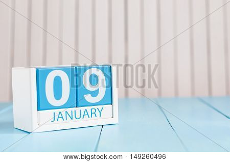 January 9th. Day 9 of month, calendar on wooden background. Winter concept. Empty space for text.