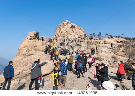 SoulKorea-Jan 3 2016:Tourists climb to the highest point of view on top of a hill in Korea.