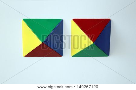 Polygon pyramids with triangular 3-D shapes in yellow, red, blue, green.