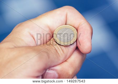 Businessman hand tossing coin to flip on heads or tails concept of chance opportunity and decision making