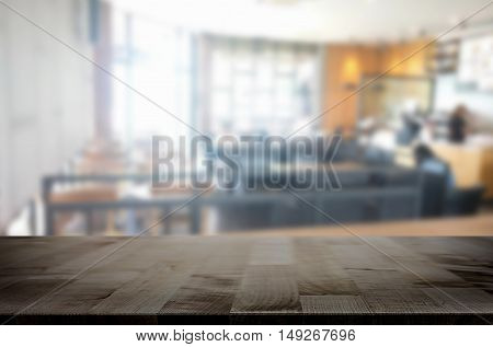 Selected focus empty brown wooden table and Coffee shop blur background with bokeh image. for your photomontage or product display
