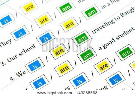 closeup colorful english grammar test sheet for background