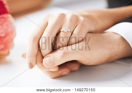 picture of man and woman holding hands with wedding ring. Husband and wife holding hands. Wedding Ceremony.