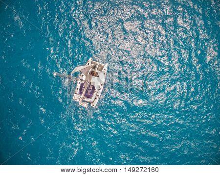 Aerial view of catamaran sailing in ocean open water