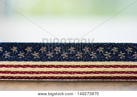 Background for American election or commemorative event. A textile with stars and stripes pattern on table.