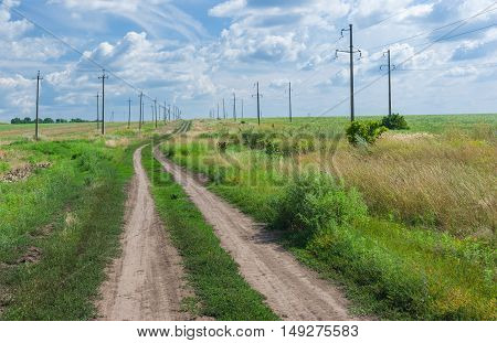 Ukrainian Landscape with country road at summer season.