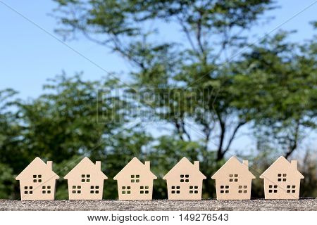 wooden toy house with tree and blue sky background