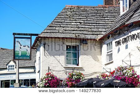 CORFE, UNITED KINGDOM - JULY 19, 2016 - Part of The Greyhound pub in the centre of the village Corfe Dorset England UK Western Europe, July 19, 2016.