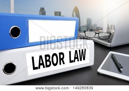LABOR LAW Office folder on Desktop on table with Office Supplies. poster