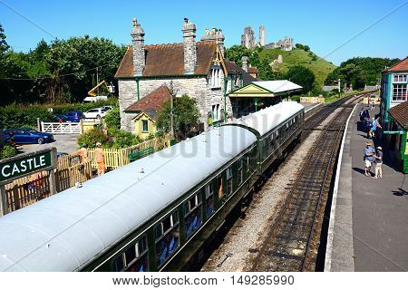 CORFE, UNITED KINGDOM - JULY 19, 2016 - BR Class 108 diesel train in the railway station with the castle to the rear Corfe Dorset England UK Western Europe, July 19, 2016.