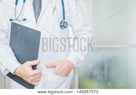 close up of patient and doctor taking notes. Doctor man. Doctor woman. Tool doctor. Uniform doctor. Clipboard in hand doctor. Doctor room.