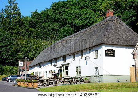 MILTON ABBAS, UNITED KINGDOM - JULY 19, 2016 - View of the Hambro Arms along the main village street Milton Abbas Dorset England UK Western Europe, July 19, 2016.