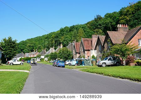MILTON ABBAS, UNITED KINGDOM - JULY 19, 2016 - Pretty cottages along the main village street Milton Abbas Dorset England UK Western Europe, July 19, 2016.