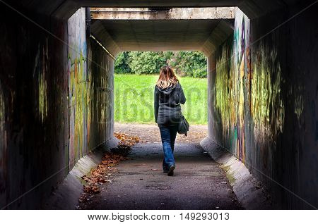 woman tunnel walk alone underspass dangerous places