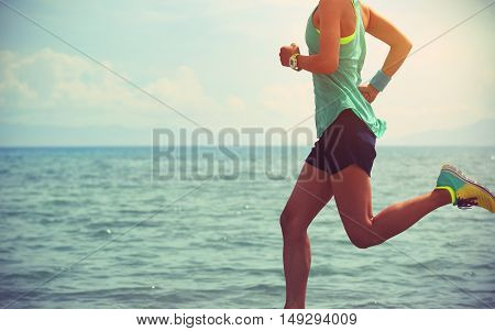 healthy young fitness woman trail runner running on seaside