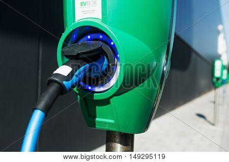 TILBURG, NETHERLANDS - SEPTEMBER 25, 2016: Electric vehicle charging station in  Tesla Supercharger Station of Tilburg, Netherlands.