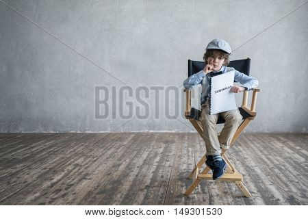 Boy with a screenplay in studio