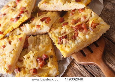 Alsatian Onion Pie With Ham On Wooden Table. Horizontal