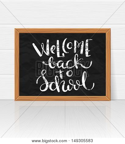 Welcome back to school handdrawn on board. Calck lettering ower calckboard, vector illustration