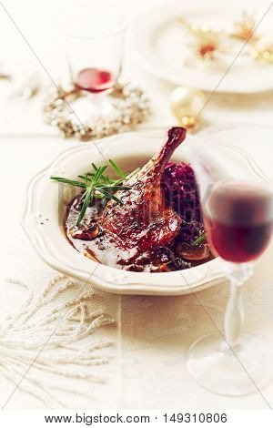 Christmas duck leg with red cabbage and mushroom sauce