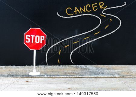Mini Stop Sign On The Road To Cancer