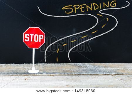 Mini Stop Sign On The Road To Spending