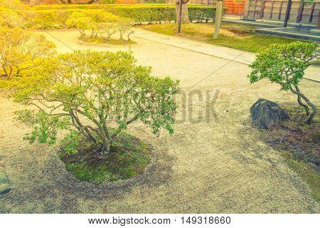 Japanese zen garden meditation stone ,Filtered image processed vintage effect.
