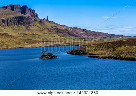Landscape view of Old Man of Storr rock formation and Loch Fada lake, Scotland, United Kingdom.