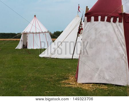 Group of Tents on Meadow set up for Medieval Event Reconstruction